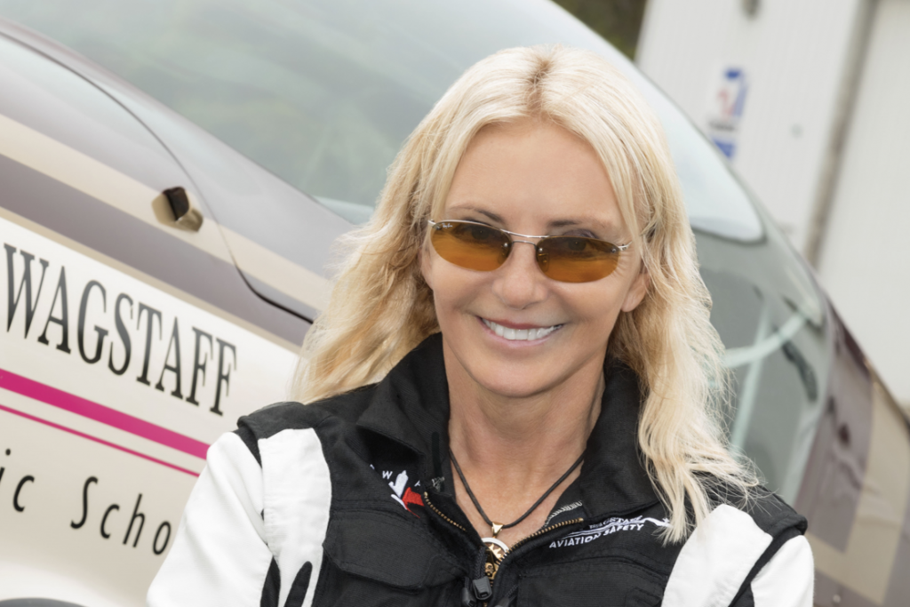 Patty Wagstaff in front of her airplane.